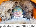 Portrait of sleeping newborn baby in warm winter 28422361