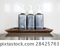 three pump bottles 28425763