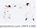 The woman and man wearing fencing suit practicing 28451286