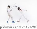The woman and man wearing fencing suit practicing 28451291