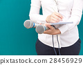 Female reporter or journalist at press conference 28456929