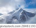 Snow covered landscape with clouds and trees 28461193