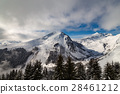 Mountains covered with snow and clouds and trees 28461212