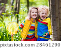 Children playing outdoors catching frog 28461290