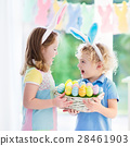 Kids with eggs basket on Easter egg hunt 28461903