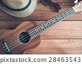 Ukulele guitar on wooden table 28463543