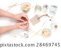 Female hands make the natural cosmetic 28469745