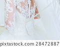 Garter on the leg of a bride, Wedding day moments 28472887