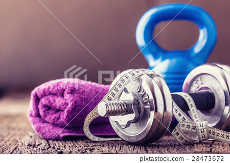 Kettlebell dumbbell towel water and measuring tape 28473672