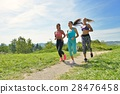 Three Female Joggers running together outdoors 28476458