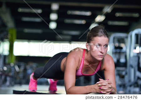 Shot of a fit young woman doing stretching workout 28476476