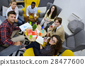 Young team of freelancers searching information 28477600