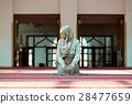 Young beautiful Muslim Woman Praying In Mosque 28477659