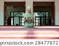 Young beautiful Muslim Woman Praying In Mosque 28477672