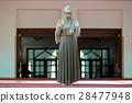Young beautiful Muslim Woman Praying In Mosque 28477948