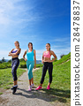 Three Female Joggers running together outdoors 28478837