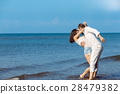 romance on vacation: couple in love on the beach 28479382