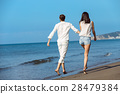 Couple walking on beach. Young happy interracial 28479384