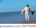 romance on vacation: couple in love on the beach 28479388