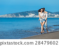 happy couple running on the beach 28479602