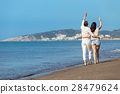 Couple walking on beach. Young happy interracial 28479624