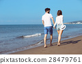 Couple walking on beach. Young happy interracial 28479761