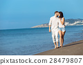Couple walking on beach. Young happy interracial 28479807