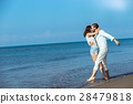 romance on vacation: couple in love on the beach 28479818