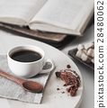 fresh coffee with cookie and book 28480062