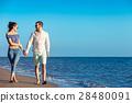 walking beach couple 28480091