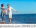 walking beach couple 28480129