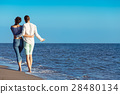 walking beach couple 28480134