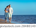 Couple walking on beach. Young happy interracial 28480140