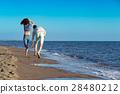 happy couple running on the beach 28480212