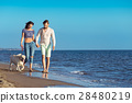 two young people running on the beach kissing and 28480219