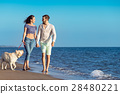 two young people running on the beach kissing and 28480221