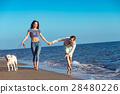 two young people running on the beach kissing and 28480226