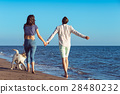 two young people running on the beach kissing and 28480232