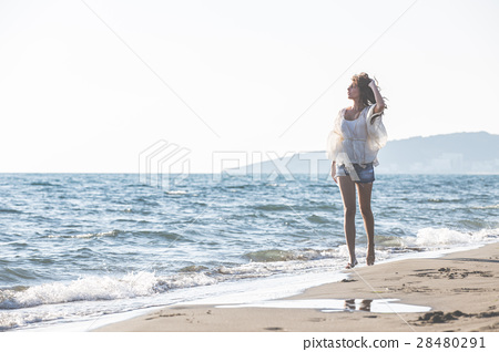 Young female enjoying sunny day on tropical beach 28480291