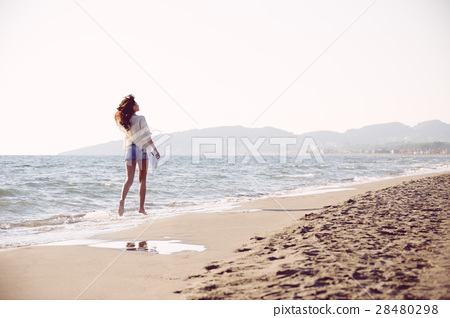 Young female enjoying sunny day on tropical beach 28480298