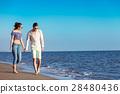 walking beach couple 28480436