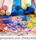 Pile of crushed chalk and pastel crayons 28482498
