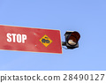 The red stop sign and light for the train 28490127