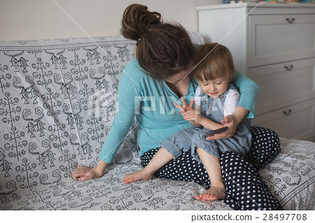 mom and son Toddler playing with phone lifestyle 28497708