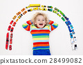 Little boy playing with toy cars. Toys for kids. 28499082