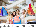 happy Women group Carrying Shopping Bags in mall 28508206