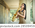 Girl playing saxophone solo music  28509459