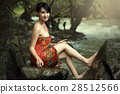 Spa woman relaxing in a natural Creek. 28512566