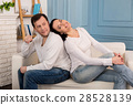 Joyful beautiful woman leaning on her husband 28528139