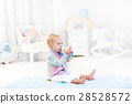 Baby boy with bottle drinking milk or formula 28528572